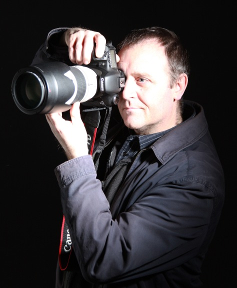 A Man With His Camera at work in the studio